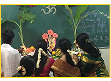 The faculty offering prayers on the occasion of Saraswati Puja